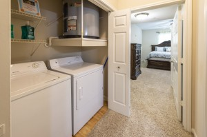 Two Bedroom Apartments for Rent in Northwest Houston, TX - Model Laundry Room with Bedroom View